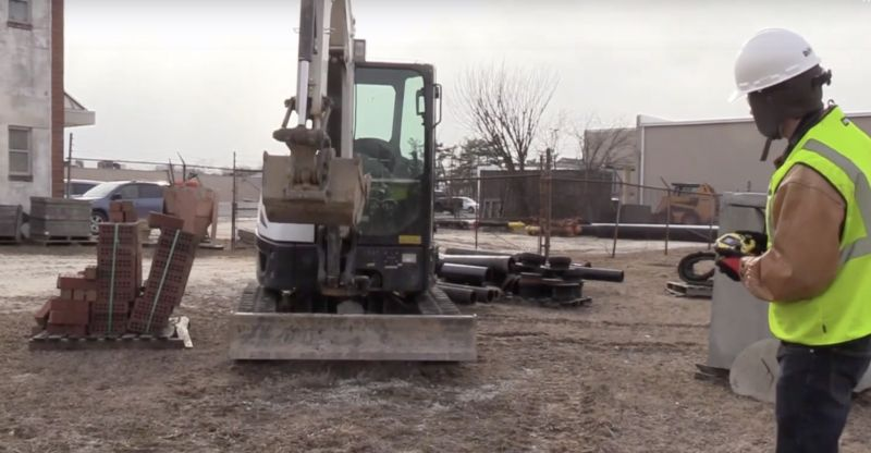 An operator puts an excavator to work with a game-style controller using Stanley's ROC remote operating system.