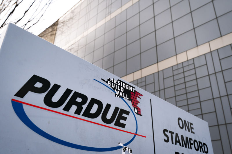 Purdue sign outside a large glass building.