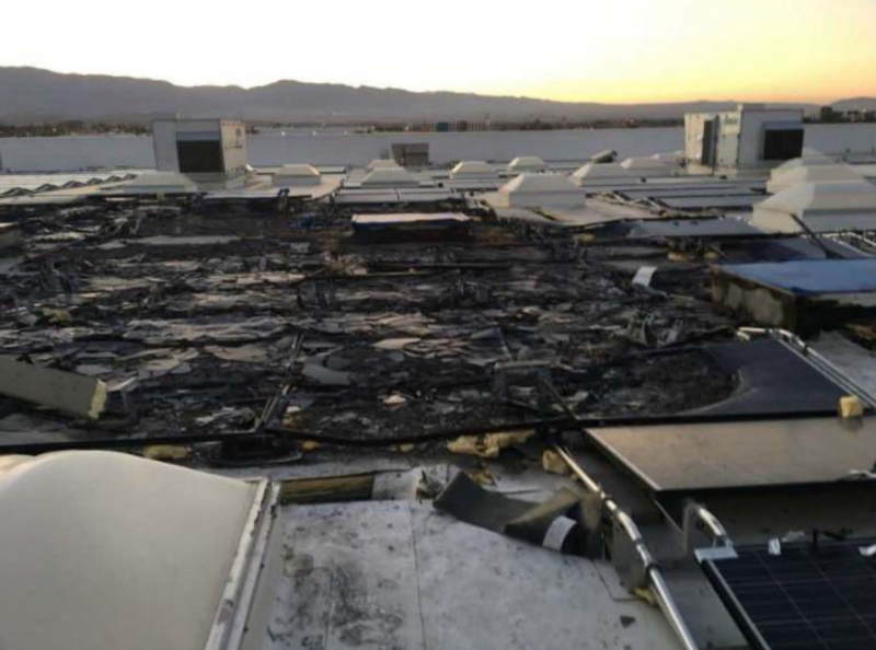 Fire damage on the roof of a Walmart store in Indio, California.