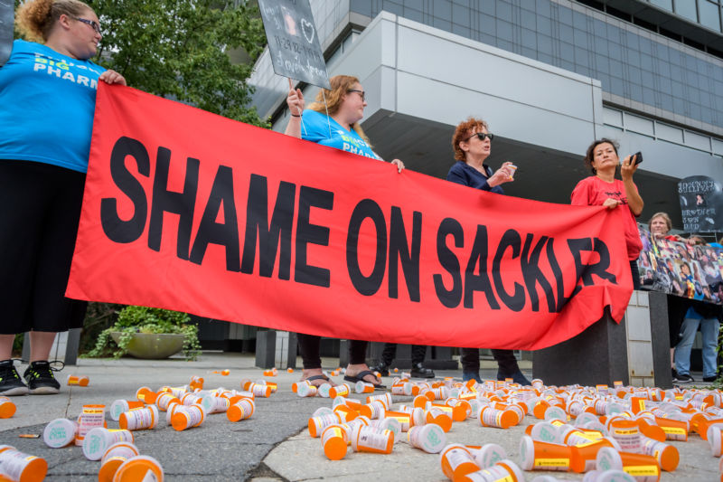 PURDUE PHARMA, STAMFORD, CT, UNITED STATES - 2019/09/12: Members of P.A.I.N. (Prescription Addiction Intervention Now) and Truth Pharm staged a protest on September 12, 2019 outside Purdue Pharma headquarters in Stamford, over their recent controversial opioid settlement.