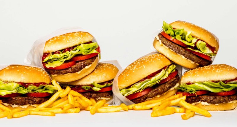 Promotional image of burgers and fries.