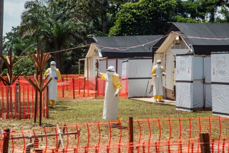 Health workers operate within an Ebola safety zone in the Health Center in Iyonda, near Mbandaka, on June 1, 2018.