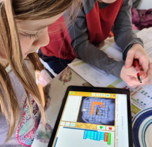 A girl doing digital making on a tablet