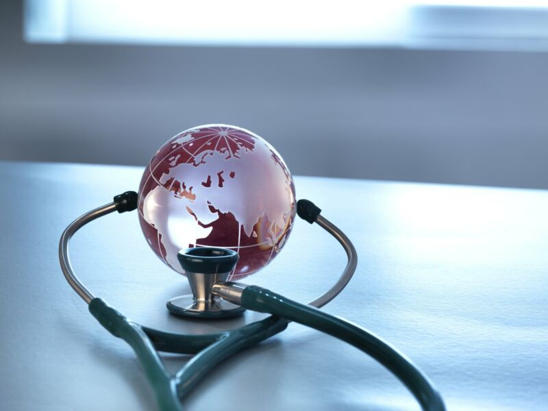 A stethoscope being used on a small globe.