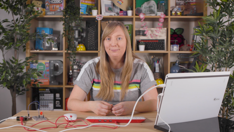 Carrie Anne Philbin MBE sitting at a disk with physical computing equipment