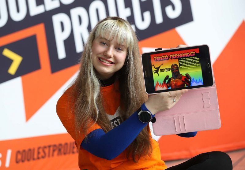 A teenage girl presenting a digital making project on a tablet