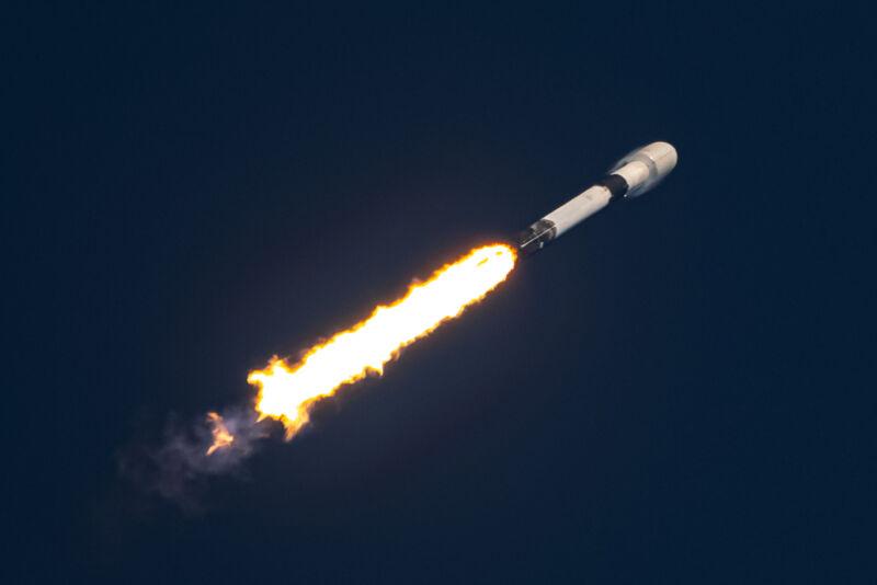 Flame follows a rocket as it streaks into the sky.