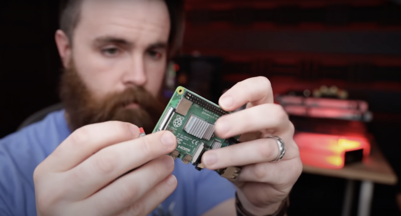 Network Chuck removing SD card from Raspberry Pi 4