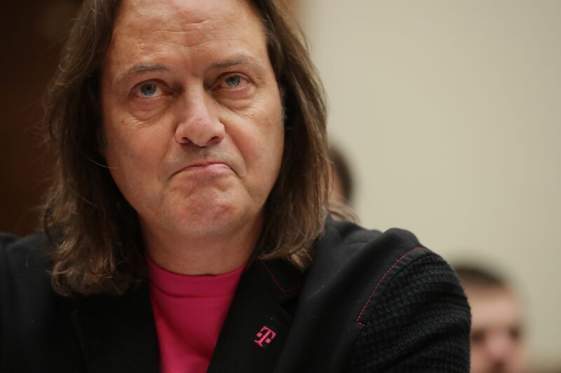Then-T-Mobile CEO John Legere testifying at a Congressional committee hearing.