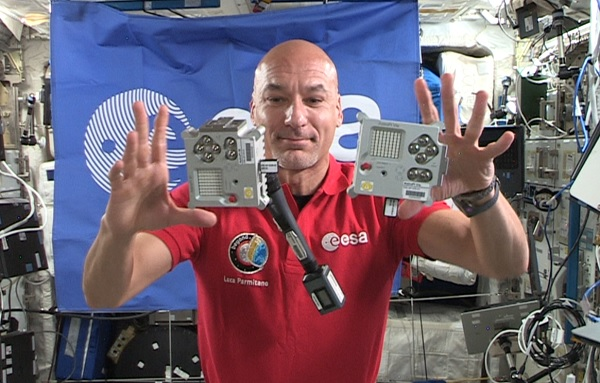 ESA Astronaut Luca Parmitano floating aboard the ISS with two Astro Pi computers
