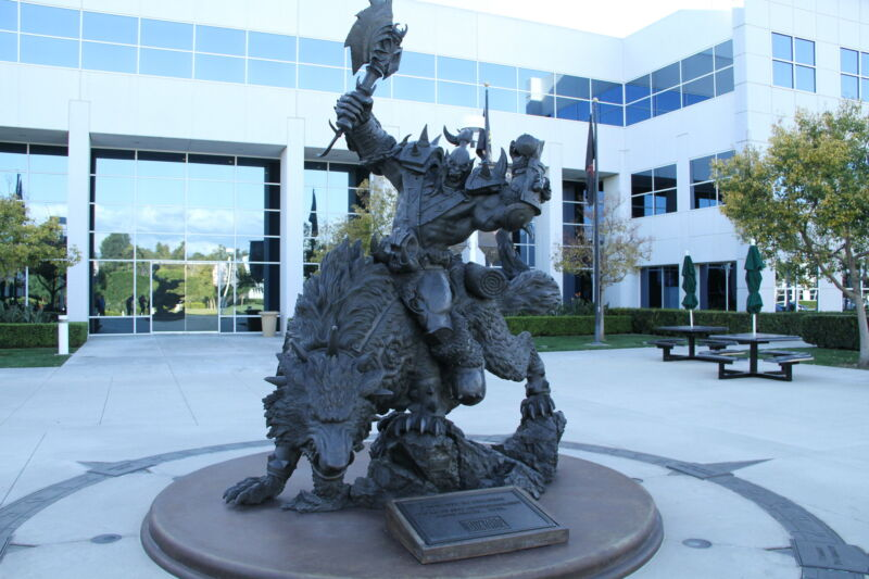 A <>em>Warcraft</em>-themed statue sites in front of the Blizzard employee campus.