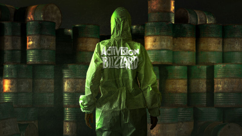 Photoshopped image from a video game shows a person in an Activision Blizzsard hoodie confronted barrels filled, presumably, with gasoline.