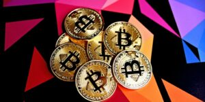 bitcoins on a multi colored background