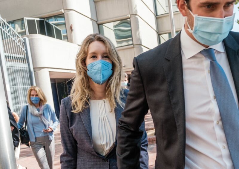 Elizabeth Holmes, founder and former CEO of blood-testing and life sciences company Theranos, leaves the courthouse with her husband Billy Evans after the first day of her fraud trial in San Jose, California, on September 8, 2021.