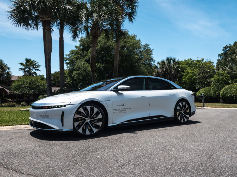 A Lucid Air prototype parked in front of some palm trees