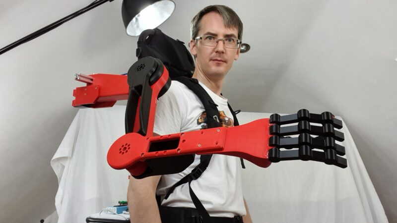 Equipped with three heavy-duty servos, the prosthetic arm moves naturally based on the data from IMU sensors on the wearer's other limbs