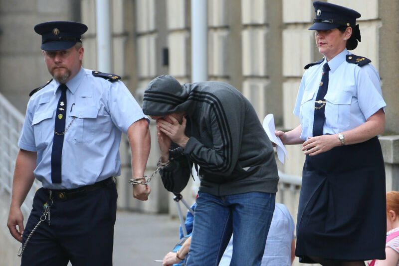 Eric Eoin Marques led away from the High Court in Dublin in August 2013 after US authorities formally requested his extradition.