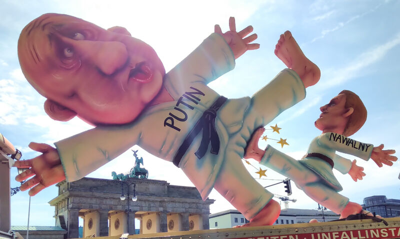 At an Anti-Putin protest in Berlin, a giant sculpture depicts Alexei Navalny kicking Vladimir Putin in the groin.