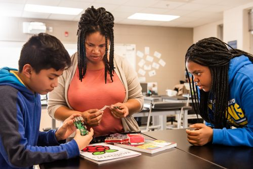 An educator teaches students to create with technology.