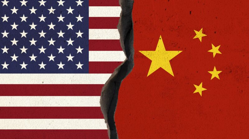 Illustration of the US and Chinese flags next to each other on a wall with a crack separating the two flags.